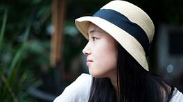 Young woman gazing off thoughtfully