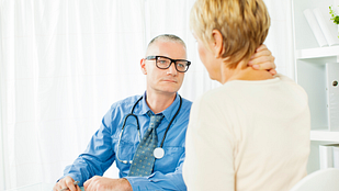Image of patient talking to her doctor about neck pain