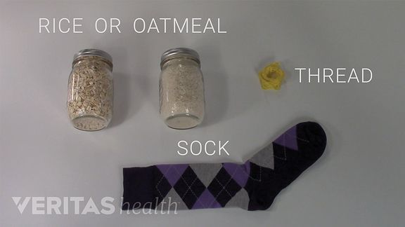 Items to make a homemade heat pack include uncooked rice or oatmeal, thread, and a sock