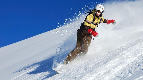 Snowboarding down a mountain