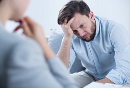 Image of man in talk therapy