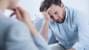 Man in talking with a therapist