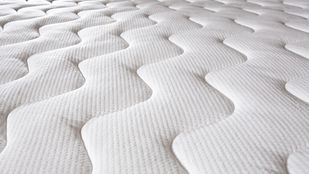 Close up of a plush mattress.