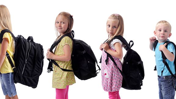 Children with heavy backpacks