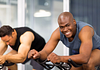 Image of man on stationary bike at the gym
