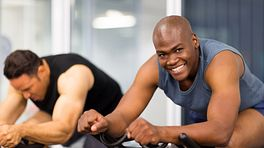 Man on stationary bike at the gym