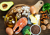 Image of healthy foods including salmon, eggs, broccoli and nuts