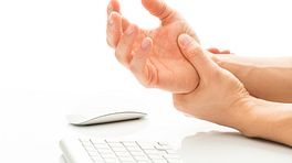 Grabbing hand in pain while working at a keyboard