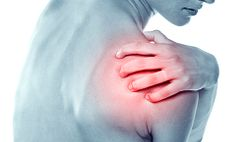 Woman grabbing their shoulder in pain.