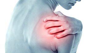 image of a young woman with acute pain in a shoulder.
