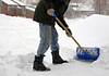 Image of a person shoveling snow