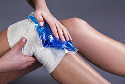 image of a person icing their wrapped knee