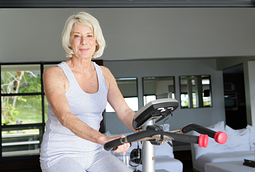 woman on stationary bicycle