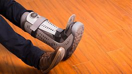 Foot with walking boot to protect the ankle.