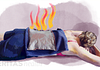 Woman lying down with a heat pack on her lower back