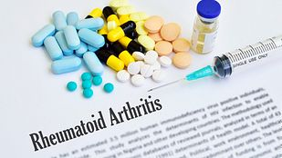 Rheumatoid arthritis definition with pills and biologics.