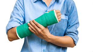 Wrist joint wrapped in a cast.