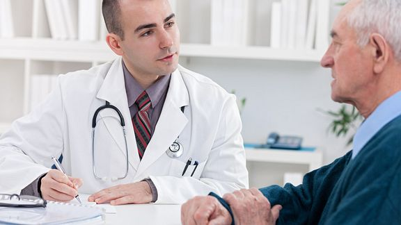 A patient talking with a doctor