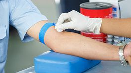 Arm being cleaned with a cotton ball for a blood test