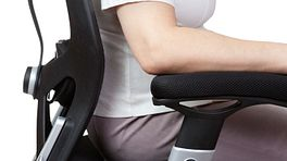Woman sitting in ergonomic office chair