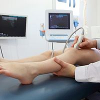 Electrotherapy being performed on the knee.