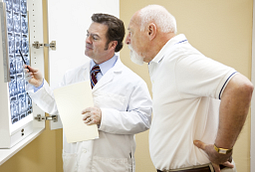 Image of doctor and patient looking at x-rays