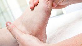 A bare foot being massaged