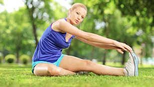 Woman stretching in the park.