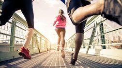 Runners running across a bridge