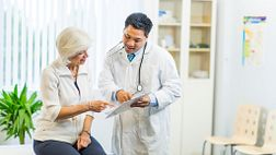 Doctor consulting a older woman in his office