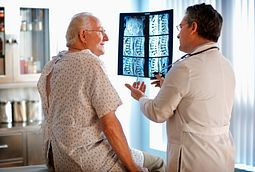 Doctor Showing Senior Patient his X-Rays