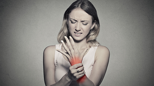 Woman grabbing wrist in pain.