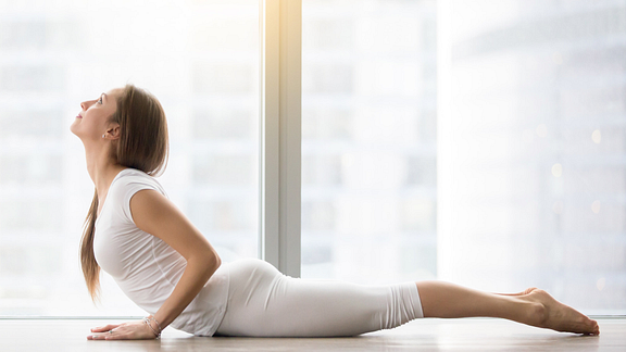 Image of woman doing the cobra yoga pose