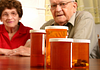 Image of senior patients looking at prescription medication