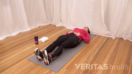 Woman lying on her back performing a piriformis muscle stretch