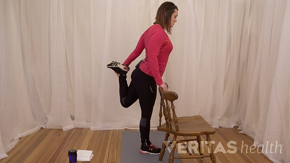 Animated video still of woman performing the standing quadriceps stretch