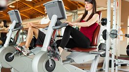 Woman riding a stationary bike at a gym