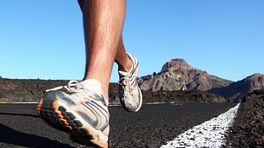 Feet running on a trail.