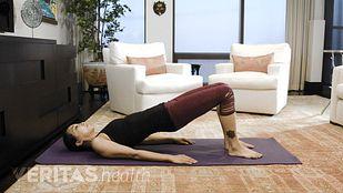 Woman performing bridge exercise for sacroiliac joint pain