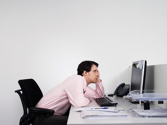 man slouching at desk