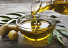 Image of olive oil being poured into a bowl
