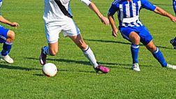 Feet playing soccer