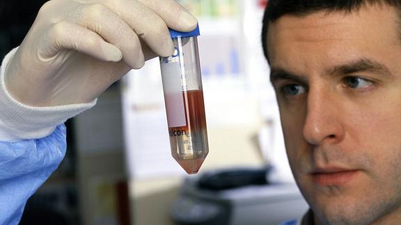 Scientist holding liquid test tube