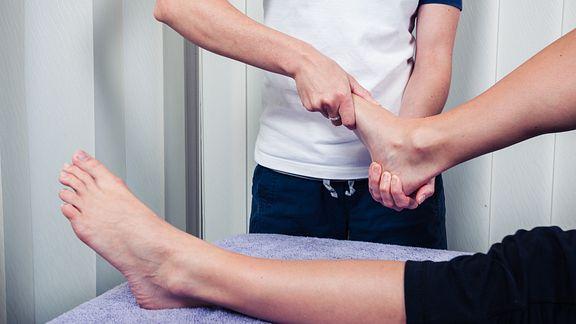 Therapist massaging the foot.