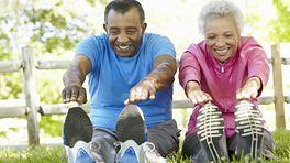 Senior couple stretching outdoors