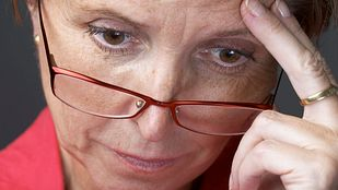 Woman's face concerned with depression