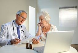 Image of doctor reviewing test results with a female patient