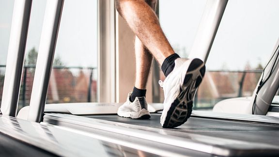 Feet running on a treadmill.