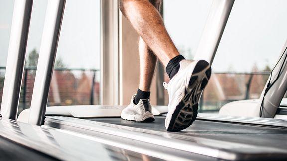 Feet running on a treadmill.