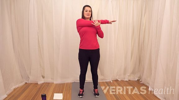 Woman doing the crossover stretch